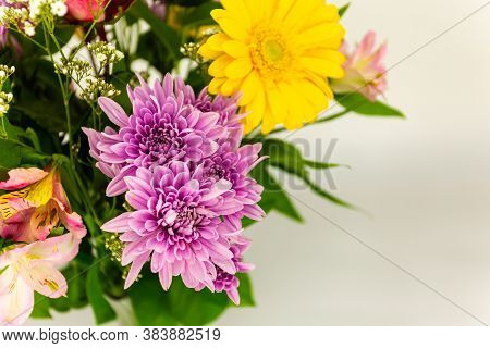 Beautiful Purple Dahlia Fowers Over A Bouquet Of Colorful Flowers With Blank Copy Space For Your Tex