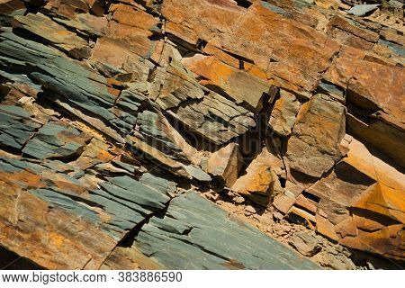 Reddish Layered Rock Wall, With Visible Geological Strata In The Andes Mountains.