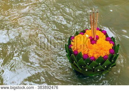 Banana Leaf Krathong Floating On River For Thailand Full Moon Or Loy Krathong Festival.