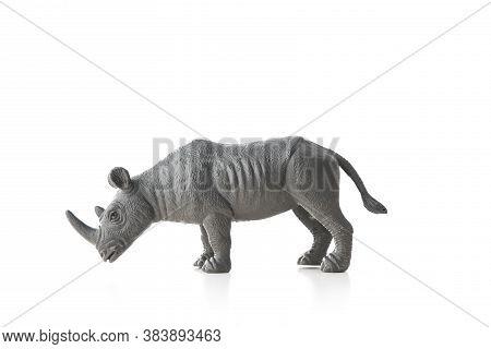 Rhinoceros Toy Isolated On White Background. Wildlife Animal.