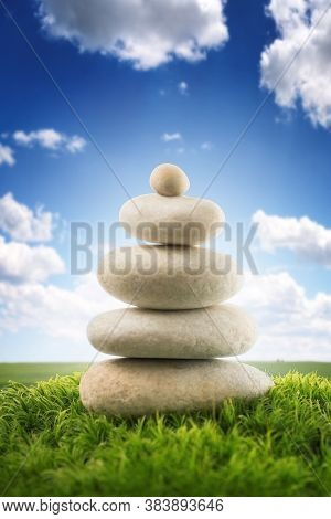 Stones Balance In A Field, Spring Shot. Zen Meditation And Relaxation.