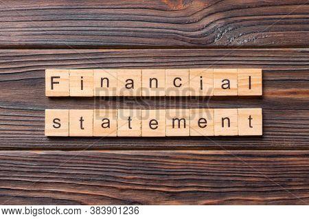 Financial Statement Word Written On Wood Block. Financial Statement Text On Cement Table For Your De
