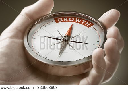 Man Hand Holding Compass With Needle Pointing The Word Growth. Investment Of Financial Concept. Comp