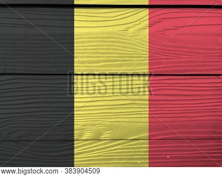 Flag Of Belgium On Wooden Wall Background. Grunge Belgium Flag Texture, A Vertical Tricolor Of Black