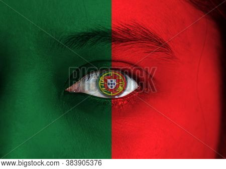 Human Face Painted Portuguese Flag With Coat Of Arms Of Portugal On The Center Of Eye Or Eyeball. Hu