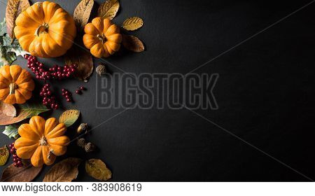 Autumn Background Decor From Dry Leaves And Pumpkin On Blackboard Background. Flat Lay, Top View Wit