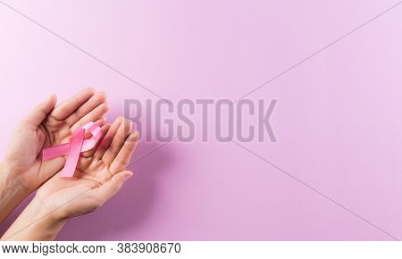Healthcare And Breast Cancer Awareness Concept. Hands Holding Pink Ribbons, Breast Cancer Awareness,