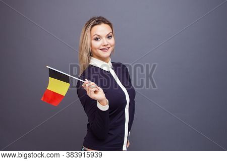 Immigration And The Study Of Foreign Languages, Concept. A Young Smiling Woman With A Belgium Flag I