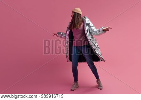 Trendy Autumn And Winter Clothing, Studio Shot On A Pink Background, Copy Space. A Cool Woman In A S