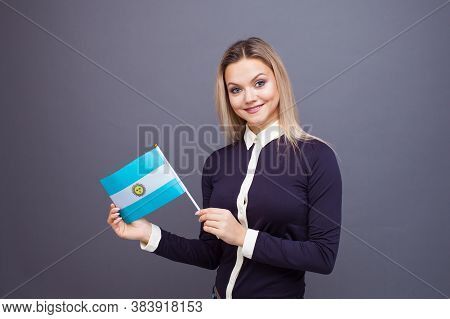 Immigration And The Study Of Foreign Languages, Concept. A Young Smiling Woman With A Argentina Flag