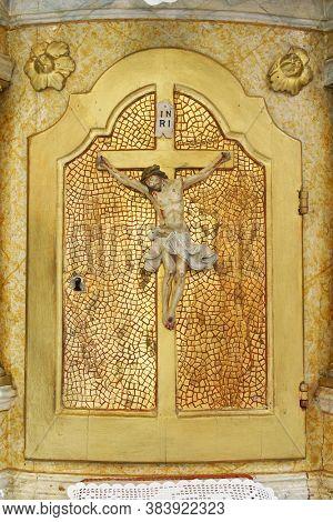 VUGROVEC, CROATIA - MAY 07, 2014: The tabernacle on the high altar in the parish church of St. Francis Xavier in Vugrovec, Croatia