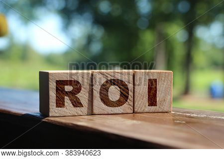 Roi. Wooden Cubes With Letters Roi. Return On Investment Business Concept