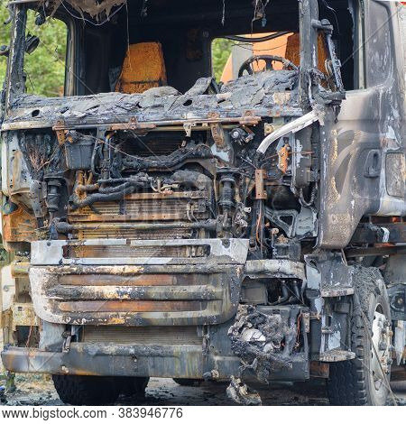 Burnt Car On The Side Of The Road. Fully Burnt Truck Cab.