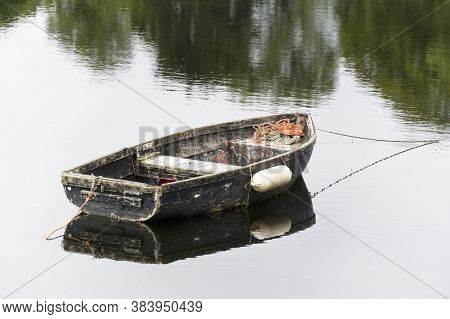 Old Wooden Boat Derelict In Sea Water For Tranquility Calm Peace And Mindfulness