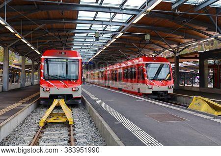 Zermatt, Switzerland-october 21, 2019:the Red Train Stop On Railway At Station Before Go To Zermatt