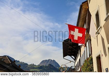 Fribourg,switzerland-october 23,2019:the Switzerland Flag In The Village In Gruyeres Castle On The T