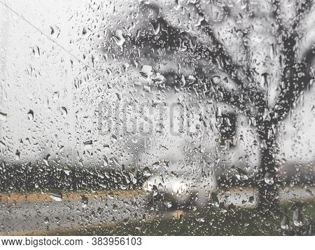 Rainy Bad Weather On The Street. Raining And Wet Weather Driving Conditions On The Road, Traffic Blu