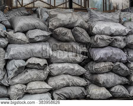 Pile Of Bags Of Soil And Coal, Agriculture, Soil Bag Stack In Warehouse. Organic Fertilizer Bag In T