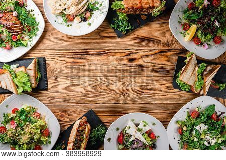 Food. Set Of Dishes Salads On The Table. On A Wooden Background. Top View. Food Background. Free Cop