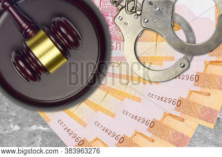 20 Belorussian Rubles Bills And Judge Hammer With Police Handcuffs On Court Desk. Concept Of Judicia