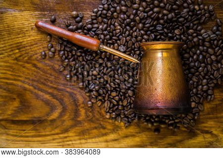 Turkish Coffee Concept. Copper Coffee Pot (cezve), Vintage Coffee Grinder, Cup, Coffee Beans On A Da