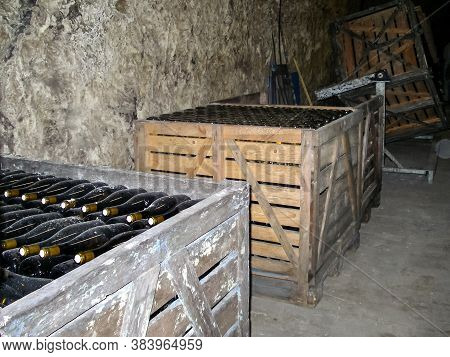 Wine Cellar With Bottles Of Wine From A French Winemaker.