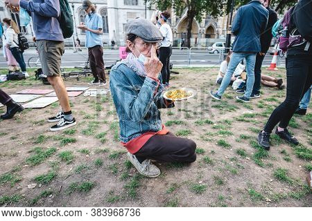 London / Uk - 2020.09.05: People Eating Free Food  At Extinction Rebellion Protest At Parliament Squ