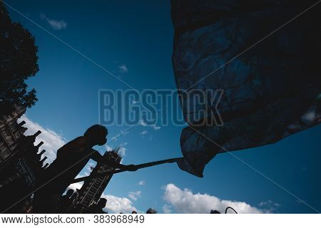 London / Uk - 2020.09.05: Young Man Waving Giant Flag At Extinction Rebellion Protest At Parliament
