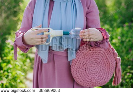 The Woman Holds In Her Hands Jars For Hijama And A Pump. Bloodletting. Muslim Hijam. The Doctor Who
