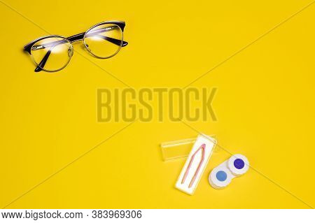Fashionable Glasses And Lenses For Vision On A Yellow Background. Vision Correction. Glasses For Sig