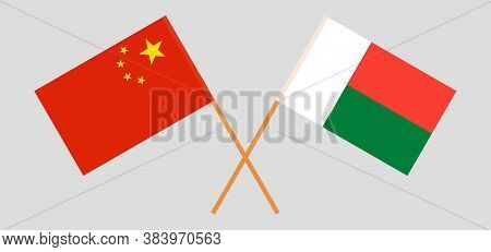 Crossed Flags Of Madagascar And China. Official Colors. Correct Proportion. Vector Illustration
