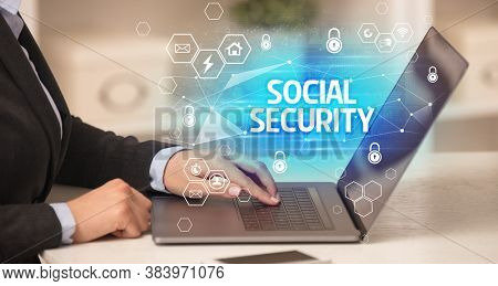SOCIAL SECURITY inscription on laptop, internet security and data protection concept, blockchain and cybersecurity
