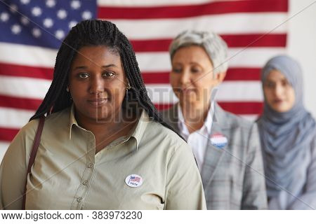 Multi-ethnic Group Of People At Polling Station On Election Day, Focus On Smiling African-american W