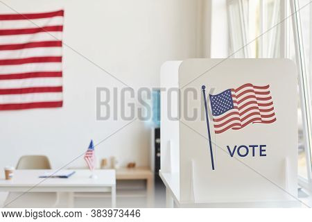 Background Image Of Voting Booths Decorated With American Flags At Empty Polling Station, Copy Space