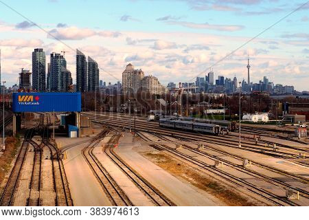 Toronto, Ontario, Canada - November 13, 2015: Toronto Skyline And Cityscape Contrasted Against A Clo