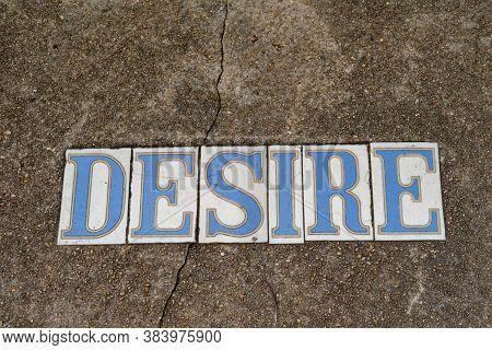 Traditional Desire Street Tile Inlay On Sidewalk In  Bywater Neighborhood On New Orleans, Louisiana,