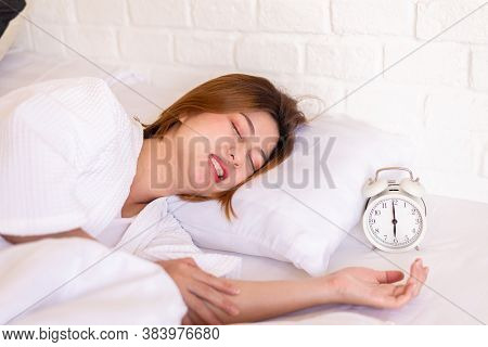 Asian Woman Sleeping On The Bed And Grinding Teeth,female Bruxism