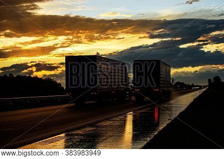 Trucks On A Sunset Background. Beautiful Truck On The Roads Of America. Business And Transport.