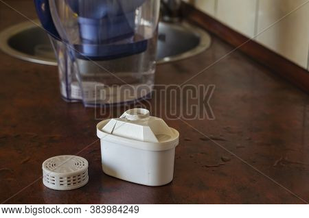 Tap Water Purification Cartridge And Silicon Filter On The Table. Devices For Purification And Enric