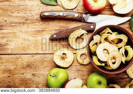 Tasty Apple Chips On Old Wooden Table