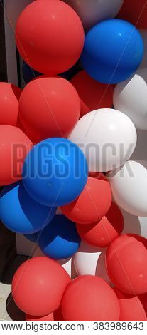 Balloons. Bright Blue, Red, White Helium Latex Balloons. A Group Of Balloons For Decorating A Childr