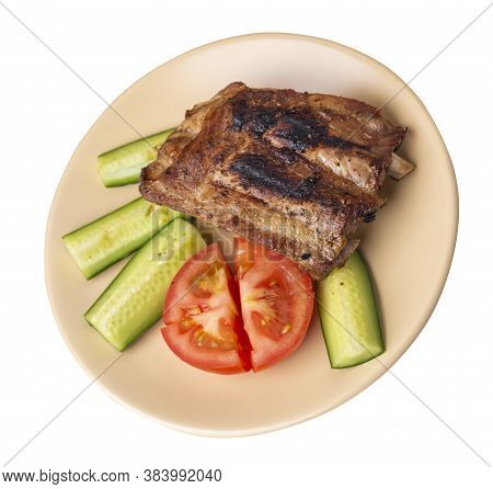 Grilled Pork Ribs With Sliced Cucumbers And Tomatoes On Beige Plate. Pork Ribs Isolated On White Bac