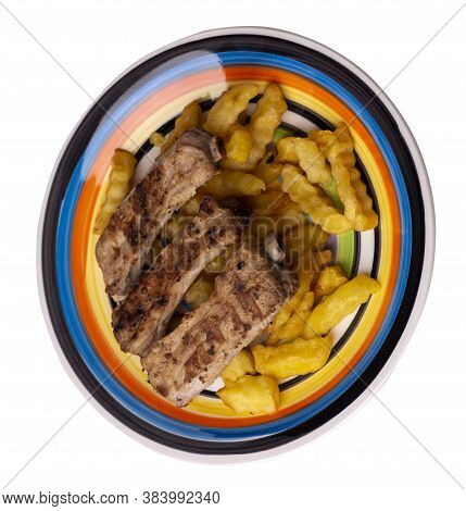 Grilled Pork Ribs With French Fries On White Black Blue Red Yellow Plate. Pork Ribs With French Frie