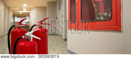 Red Fire Extinguishers Tank At The Exit Door In The Building Concepts Of Emergency Safety For Fire P