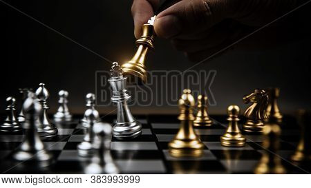 Close Up Hand Choose Gold Chess To Fight With Silver Chess Team On Chess Board Concept Of Business S