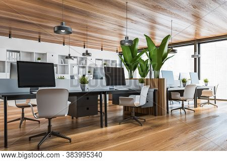 Corner Of Panoramic Open Space Office With White And Black Walls, Wooden Floor, Computer Tables And