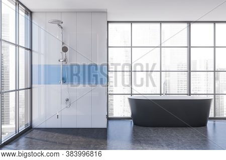 Interior Of Minimalistic Bathroom With White And Blue Walls, Concrete Floor, Shower Stall And Bathtu