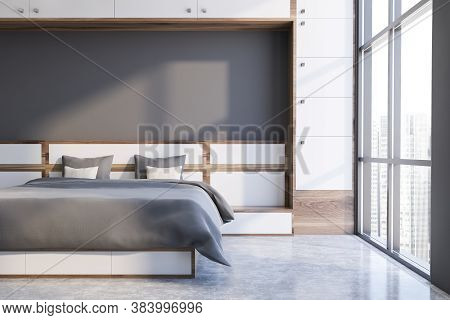 Inteiror Of Panoramic Bedroom With White And Gray Walls, Concrete Floor And Comfortable King Size Be