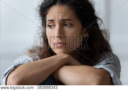 Sad Woman Sit On Sofa Feels Offended By Beloved Man