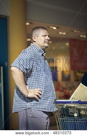 Man in store with trolley